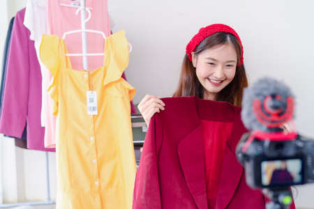 Photo pour Beautiful young Asian woman vlogger blogging presentation clothing fashion video live social media recording her selling online via digital camera, Owner small business entrepreneur people lifestyle - image libre de droit