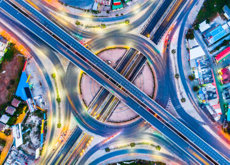 Foto de The light on the road roundabout at night and the city in Bangkok, Thailand. Aerial view - Imagen libre de derechos