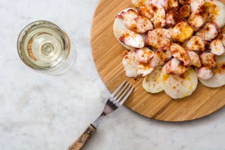 Octopus a la Gallega. Galician octopus on white marble. Typical spanish food