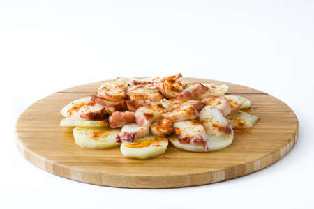 Octopus Galician. Galician octopus on wood. Typical spanish food isolated on white background