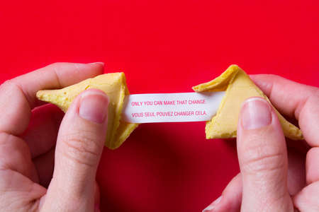 Photo pour Fortune cookie with message on paper on red background - image libre de droit