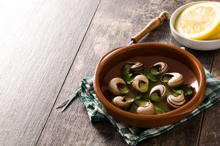 Foto de Escargots de Bourgogne. Snails with herbs and garlic butter. - Imagen libre de derechos
