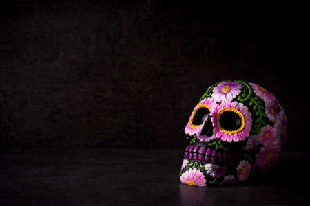 Photo for Typical Mexican skull painted on black background.Copyspace. Dia de los muertos. - Royalty Free Image