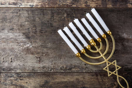 Photo for Jewish Hanukkah menorah on wooden table.Top view. Copy space - Royalty Free Image