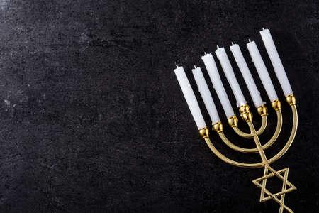 Photo for Jewish Hanukkah menorah on black background. Copy space - Royalty Free Image