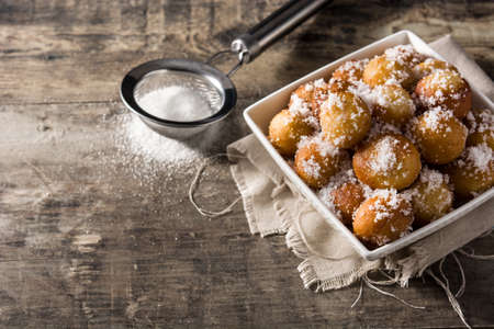 Photo for Carnival fritters or buñuelos de viento for holy week on wooden table - Royalty Free Image