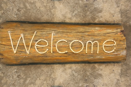 welcome wording on old wood