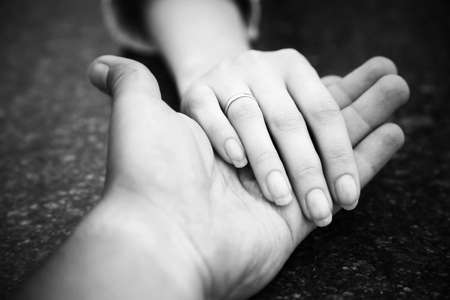 Helping hand. Black and white concept.