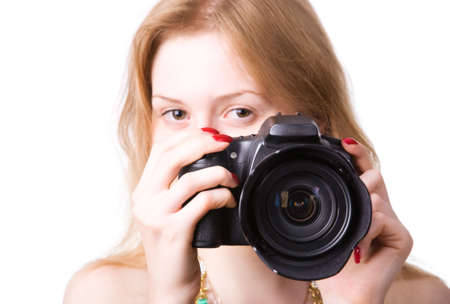 Young photographer. Isolated on white.