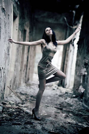 Young woman in a ruined building. Lens distortion effect for more dramatic.