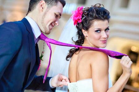 Foto de Young wedding couple indoors funny portrait. - Imagen libre de derechos