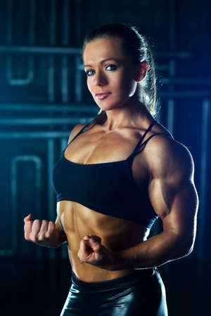 Young strong sports woman portrait