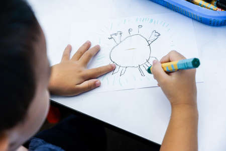 Boy drawing cartoon