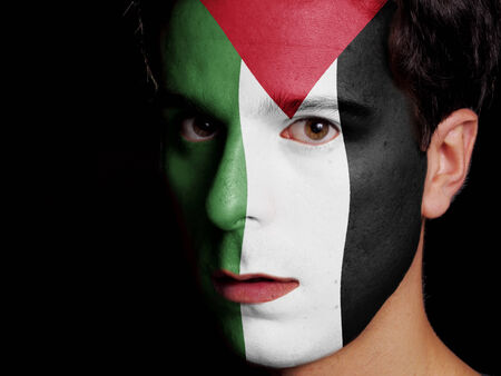 Flag of Palestine Painted on a Face of a Young Man