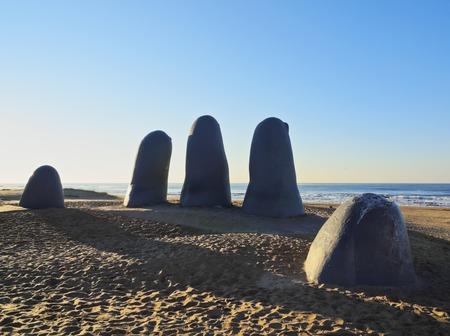 Uruguay, Maldonado Department, Punta del Este, Playa Brava, La Mano(The Hand), a sculpture by Chilean artist Mario Irarrazabal.