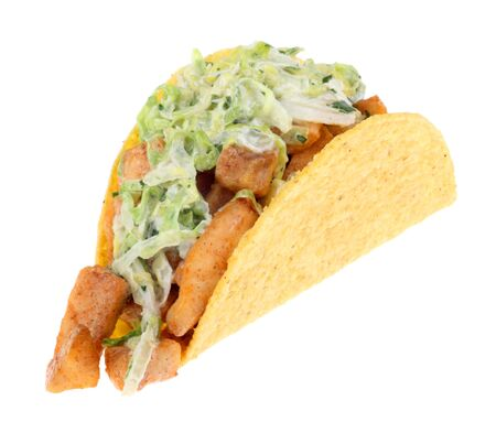 Fish taco topped with coleslaw isolated on white