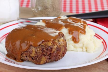 Salisbury steak with mash potatoes covered with gravy