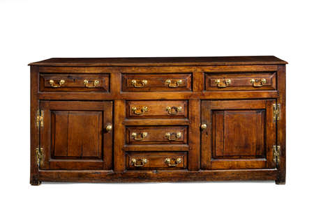 Old English antique oak dresser sideboard base with brass handles isolated with clip path 16th-17th Century