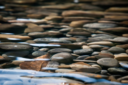 River Bed - Stones beneath the clear water of a river