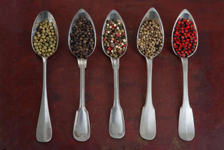 Photo pour Seasonings in silverware spoons on wooden background - image libre de droit
