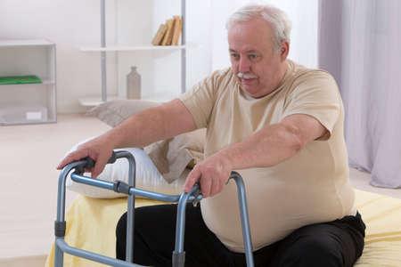 Photo pour Senior Man Using Walking Frame - image libre de droit