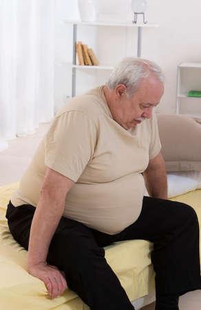 Foto de Overweight senior man Concerned With His health - Imagen libre de derechos