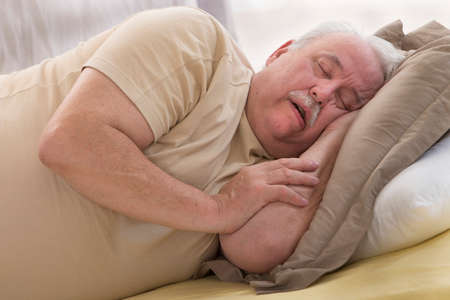 Photo pour Close up of senior man sleeping and Snoring in bed - image libre de droit