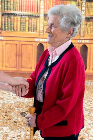 Photo pour Hands of young and senior women - image libre de droit