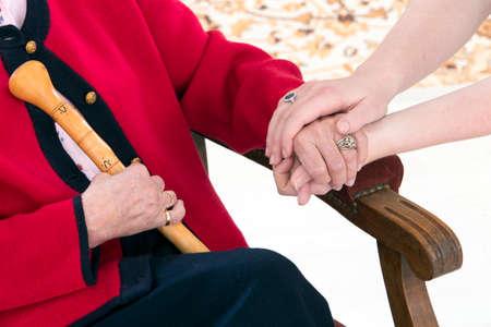 Photo pour Hands holding old person - image libre de droit