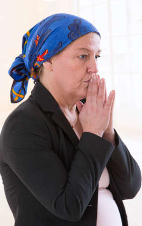 Photo pour A worried cancer patient wearing a scarf to hide her baldness. - image libre de droit