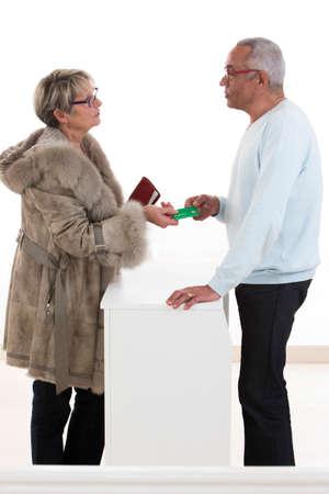 Photo pour male pharmacist talking to patients about the medical prescription - image libre de droit