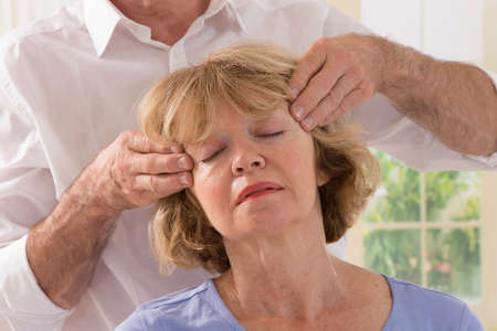 cranial osteopathy therapy doctor hands in woman hea
