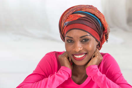 Photo for Beautiful African woman wearing a headscarf - Royalty Free Image