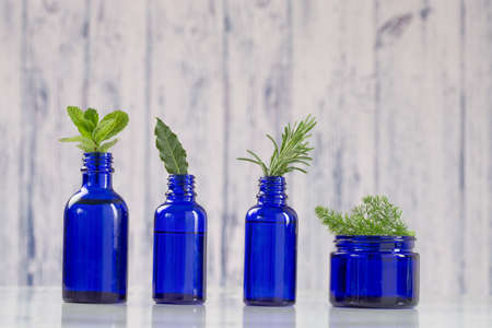 Various Aromatic essential oil  in blue bottle