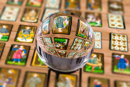 Foto de Fortune teller Crystal ball and in transparency tarot cards background . - Imagen libre de derechos