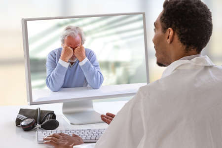 Photo for psychologist session on computer screen. Telemedicine or telehealth for a depressed senior man - Royalty Free Image