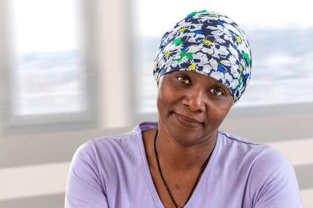 Photo pour woman cancer patient wearing headscarf. Head, hope.African, American woman smiling - image libre de droit
