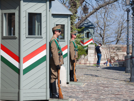BUDAPEST, HUNGARY - APRIL 8, 2017: Hungarian army guards formally wathcing the Sandor Palace, the presidential castle of Hungary, during a warm afternoon