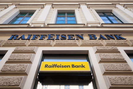 SZEGED, HUNGARY, JULY 3, 2018: Raiffeisen logo on their main bank in the center of Szeged. Raiffeisen is an Austrian bank, massively investing in Central and Eastern Europe