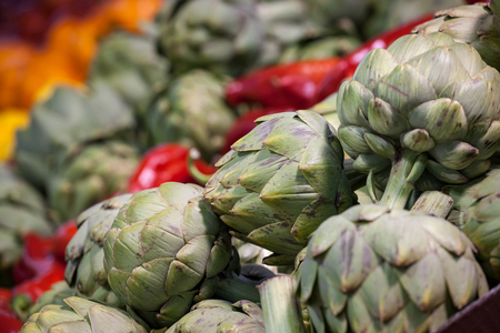 Buckets of Globe Artichokes for sale in Montreal, Quebec. Artichokes are massively produced in America, and consumed most of the Northern American continent