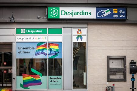 MONTREAL, CANADA - NOVEMBER 5, 2018: Desjardins Bank logo on their branch for the gay district le Village, with LGBT friendly slogan. Mouvement Desjardins is one of the main banks from Quebec