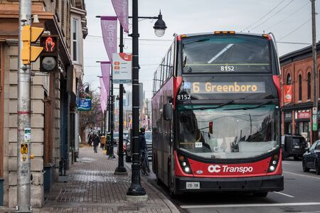 OTTAWA, CANADA - NOVEMBER 12, 2018: OC Transpo logo on one of their urban buses in downtown Ottawa. OC Transpo is the urban public transportation system of Ottawa, operating mainly buses