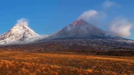 Photo pour Autumn mountain landscape view at sunrise of eruption active Klyuchevskoy Volcano (Klyuchevskaya Sopka) - highest mountain on Kamchatka Peninsula (Russian Far East), highest active volcano of Eurasia. - image libre de droit