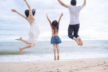 Photo pour happy family jumping together on the beach - image libre de droit