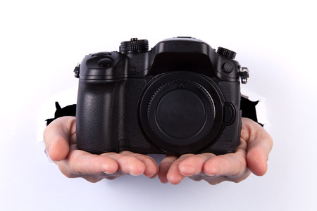 digital mirrorless camera coming out from hole