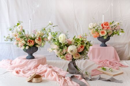 Photo pour Still life with  beautiful bouquets of flowers and candles - image libre de droit