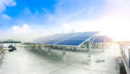 Photo for Soft focus of Solar panels or Solar cells on factory rooftop or terrace with sun light, Industry in Thailand, Asia. Can saving energy. Sun energy. renewable energy. Clean energy. - Royalty Free Image