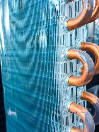 Condenser unit used in central air conditioning systems - heat exchanger (heat micro canel) section to cool down and condensate incoming refrigerant vapor into liquid. background texture. technology.