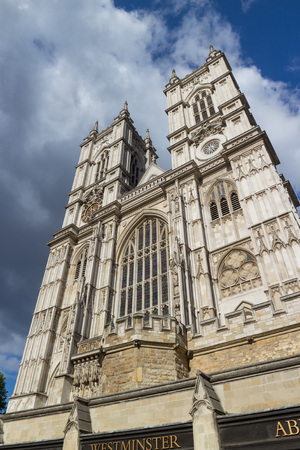 World famous Westminster Abbey cathedral front in London, England, shot against a perfect summer sky