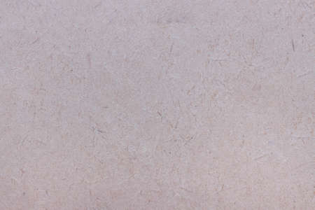 Photo for The surface of old worn brown cardboard, covered with creases and stains. Uniform light abstract texture. - Royalty Free Image